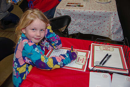 Young girl writing a letter to Santa