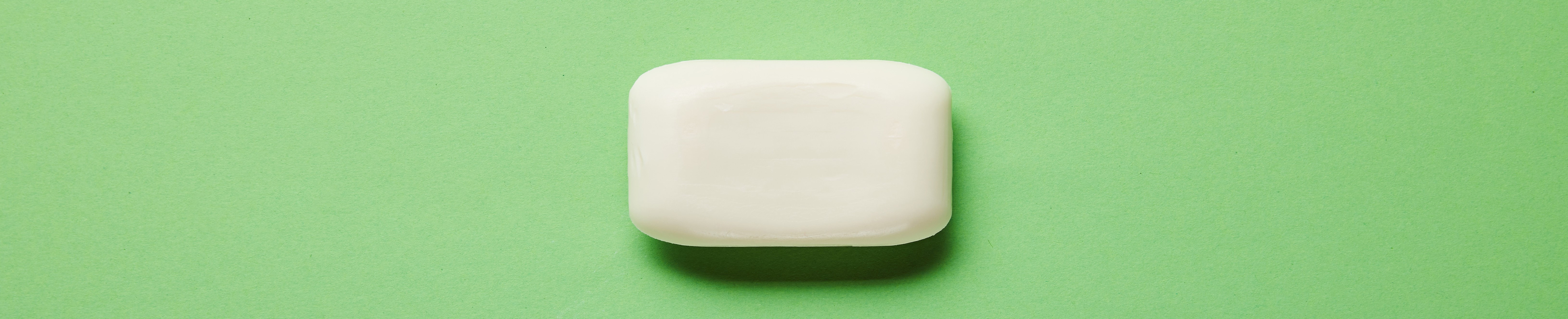 white bar soap on green background