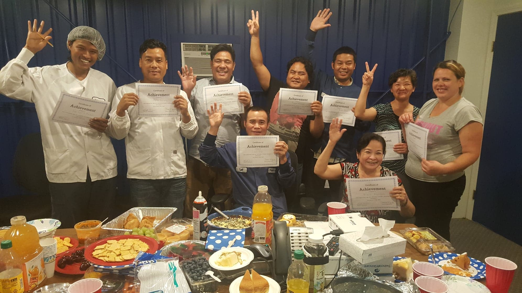 Twincraft New American employees with Certificates of Achievement for English as a Second Language Course