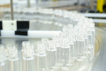 Liquid skincare bottles on production line