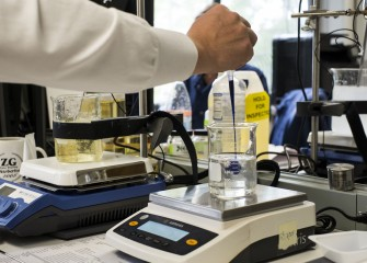 lab engineer stirring product in beaker