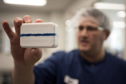Twincraft employee holding bar soap