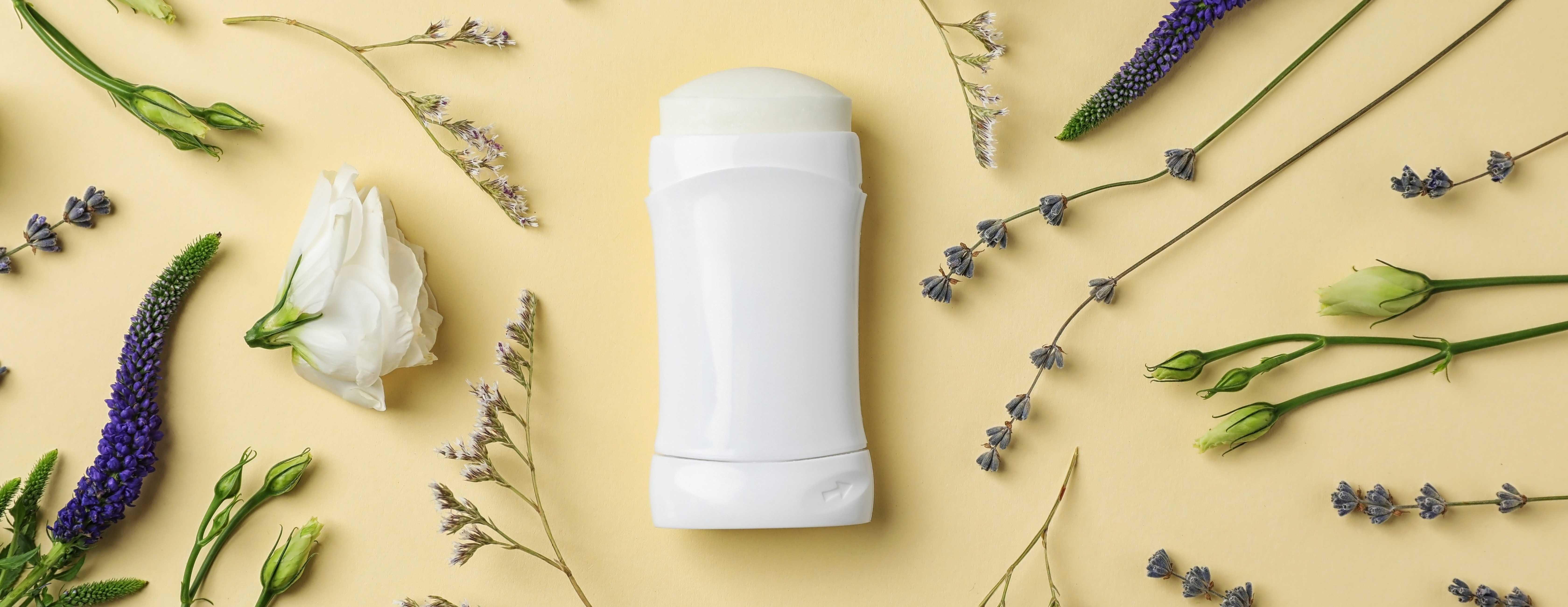 deodorant and flower flatlay - wide