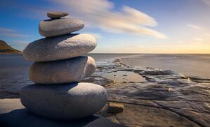 stacked stones by water