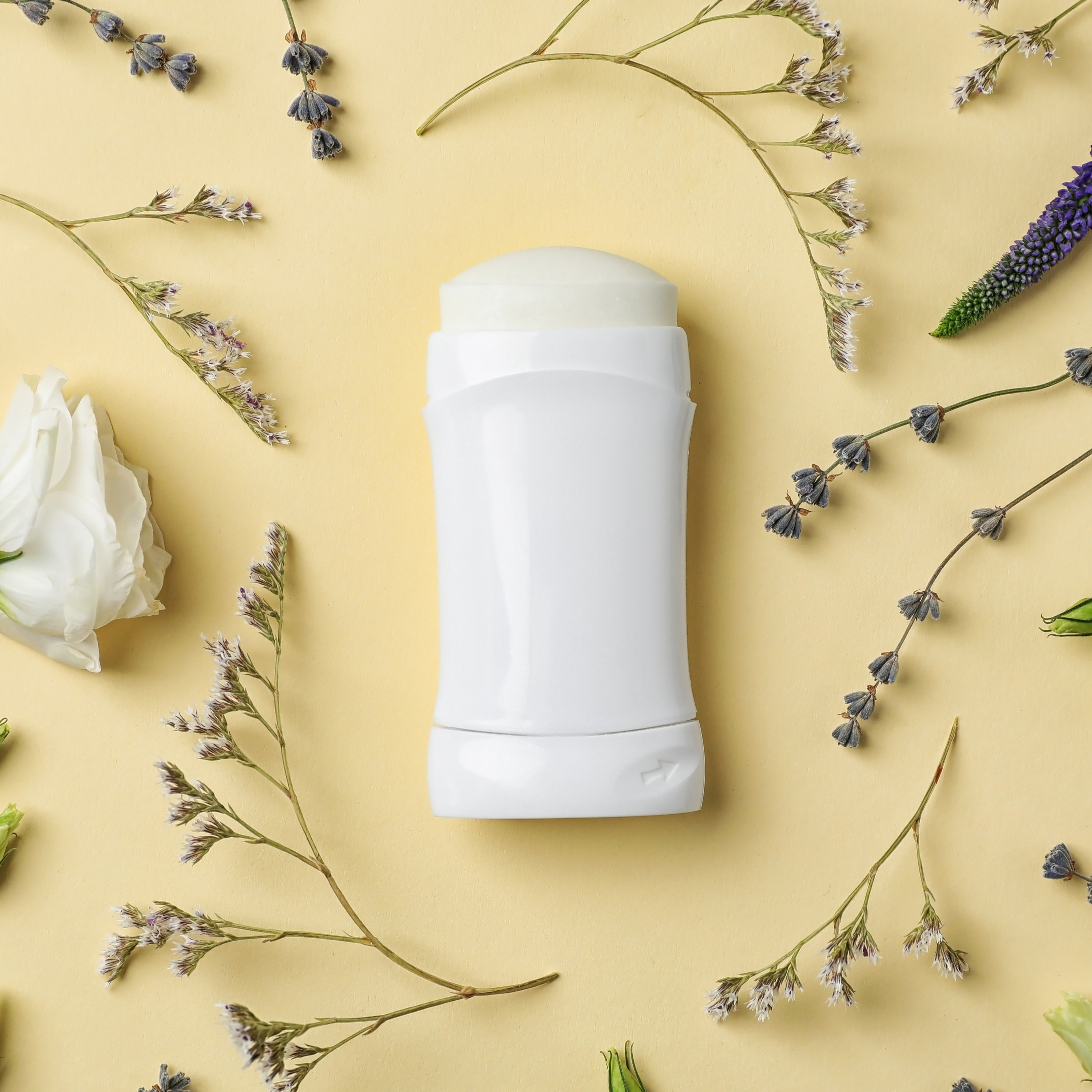 deodorant and flower flatlay - square